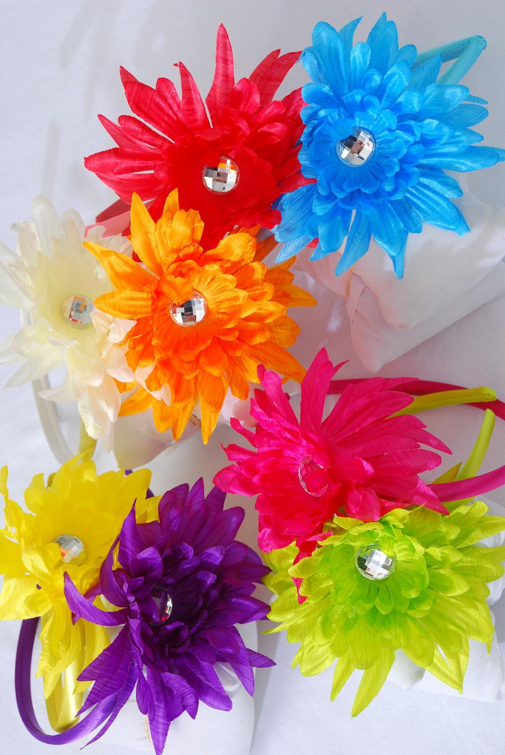 "Headband Satin Gerber Daisy/DZ **Citrus** Size-4.5"",2 Red,2 Fuchsia,2 Beige, 2 Orange,1 Blue,1 Yellow,1 Lime,1 Purple,8 Color Asst,Hang tag & UPC code,W Clear Box -"