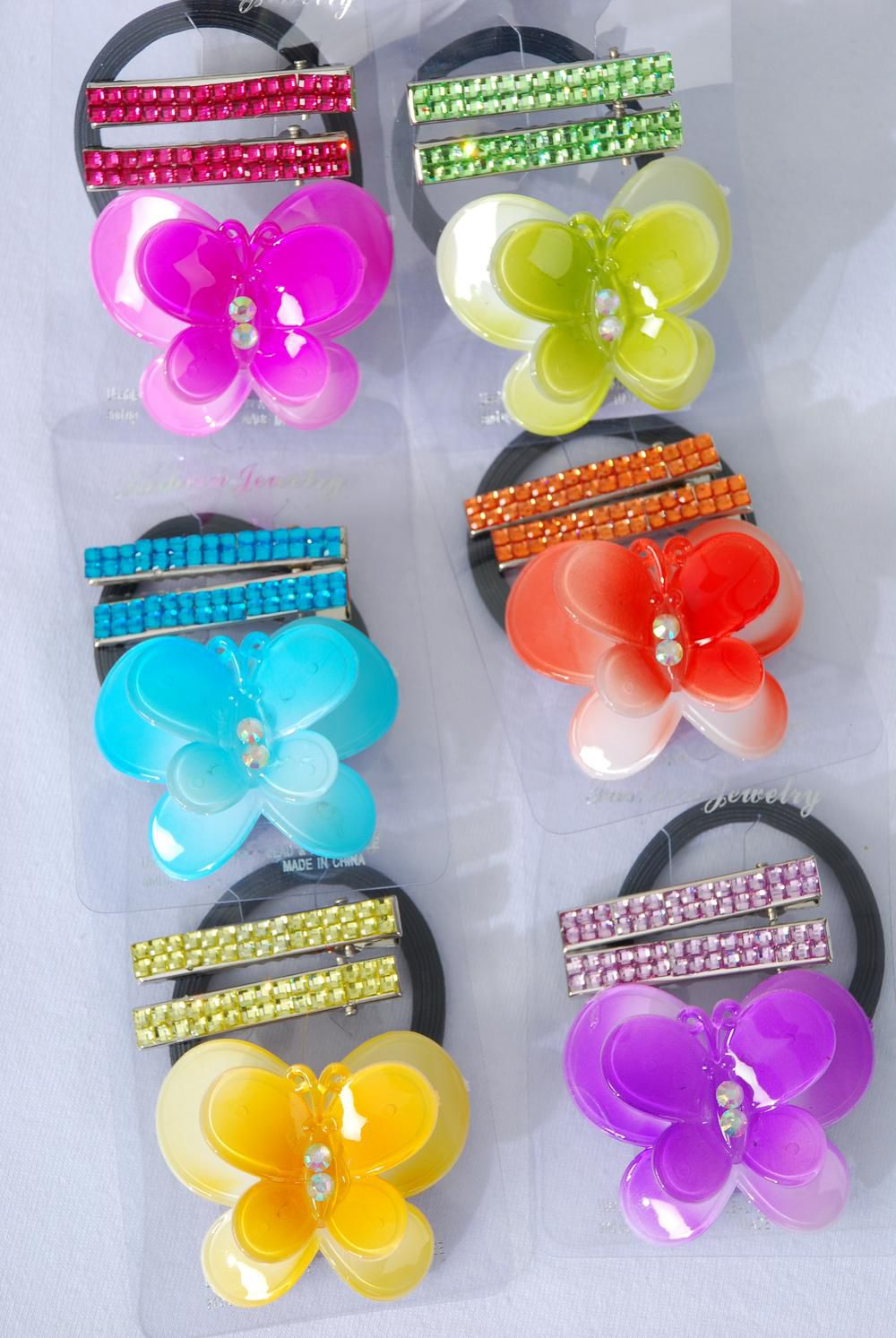 "Hair Ties Butterfly & Alligator Clip Infinity Stones/DZ Butterfly Size-2.5""x 2"",Alligator Clip,2 of each Color Asst,Individual Opp Bag & UPC Code,12 card=Dozen"