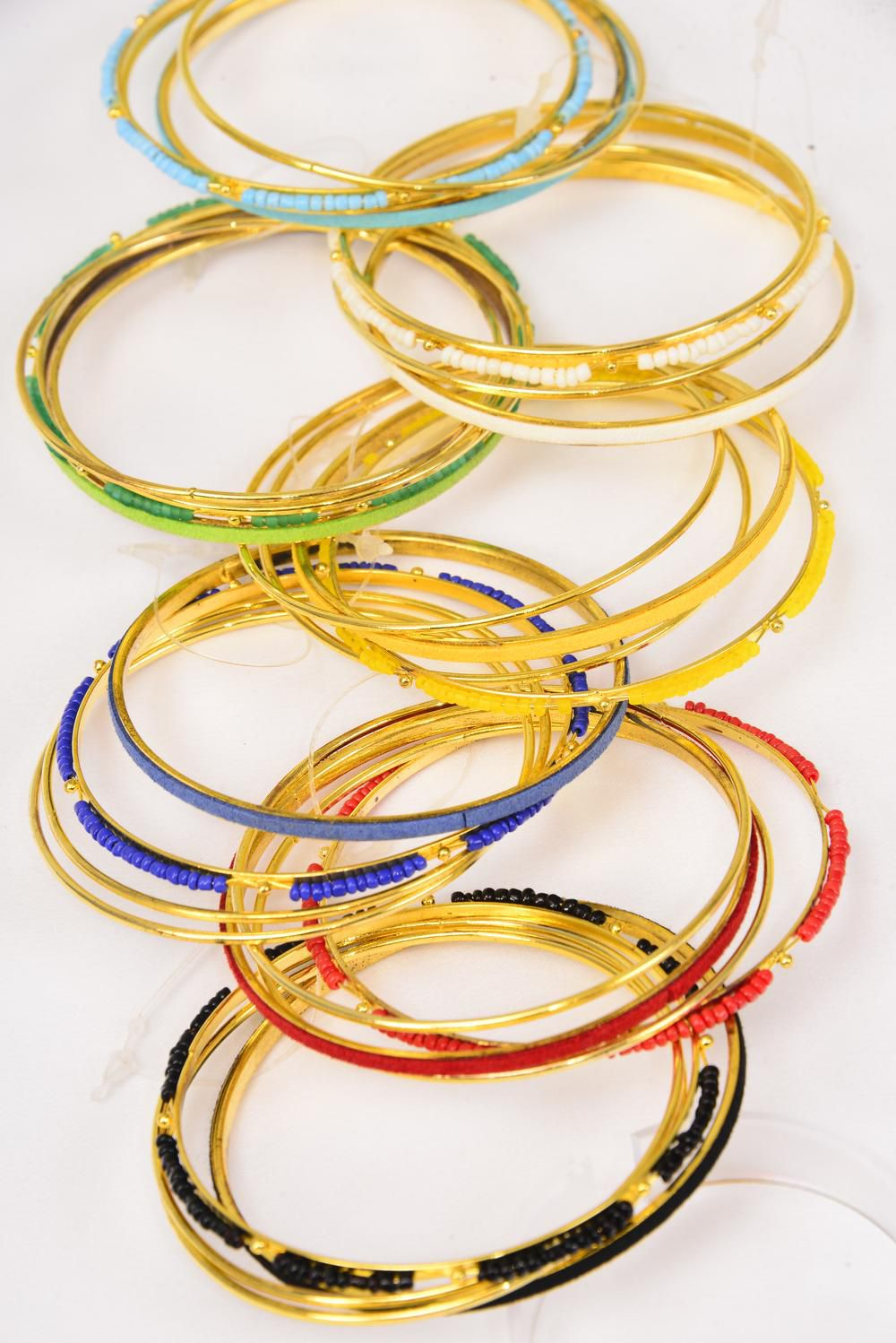 "Bangles Metal 4 pcs Gold Color Bead & Suede Mix/DZ Size-2.75"" Dia Wide,2 Black,2 White,2 Royal Blue,2 Red,2 Yellow,1 Green,1 Orange Color Asst,Hang Tag & OPP Bag & UPC Code"
