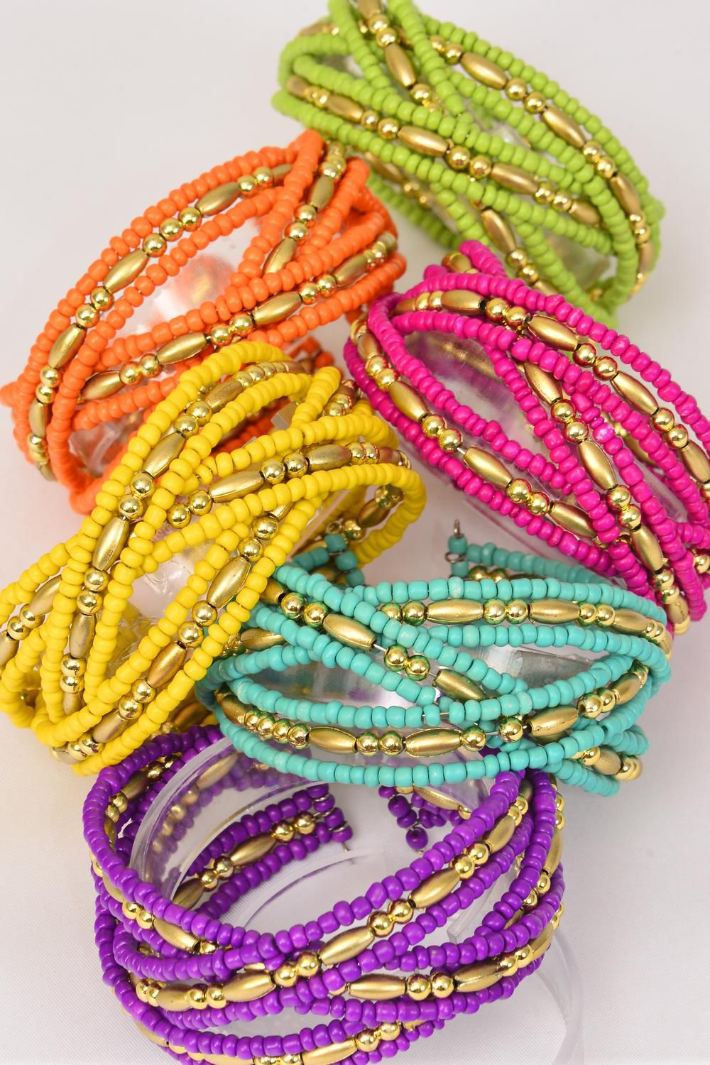 Bangle Cuff Flexible Bunch Indian Beads/DZ **Flexible** 2 Fuchsia,2 Purple,2 Gold,2 Blue,1 Yellow,1 Red,1 Orange,1 Lime,8 Color Asst,Hang Tag & OPP bag & UPC Code