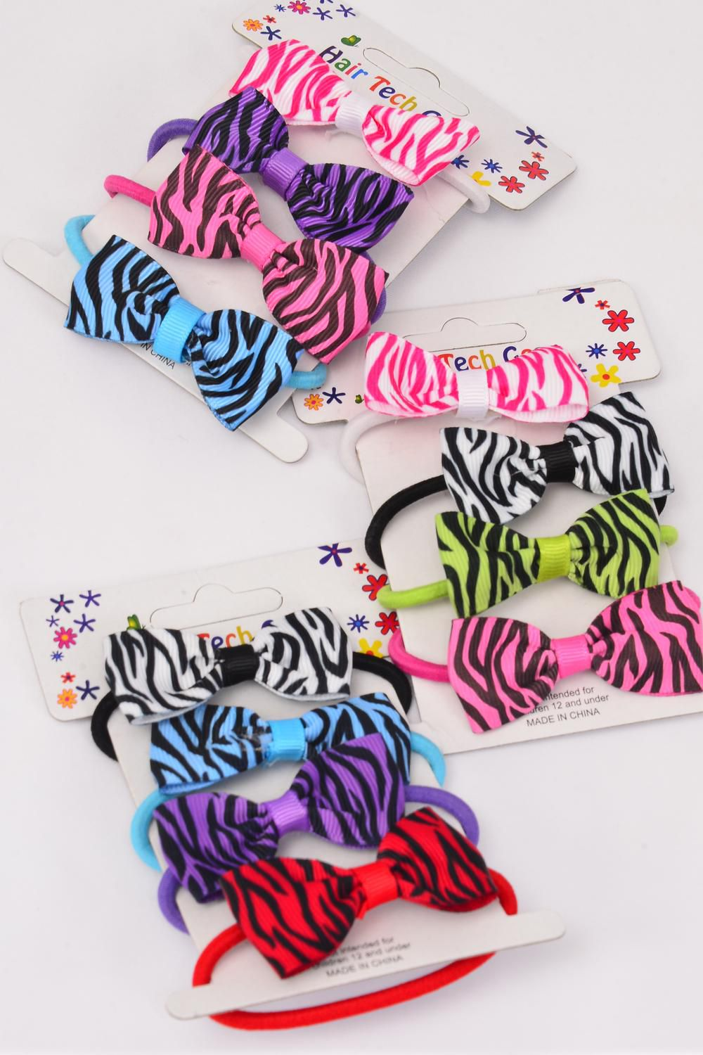 "Elastic Terry Hair Ties Grosgrain Bow-tie 4 pcs Zebra Multi/DZ **Elastic** Bow-tie Size-2""x 1"" Wide,4 of each Color Mix,Individual OPP Bag & UPC code,4pecs per Card,12 Card=Dozen"