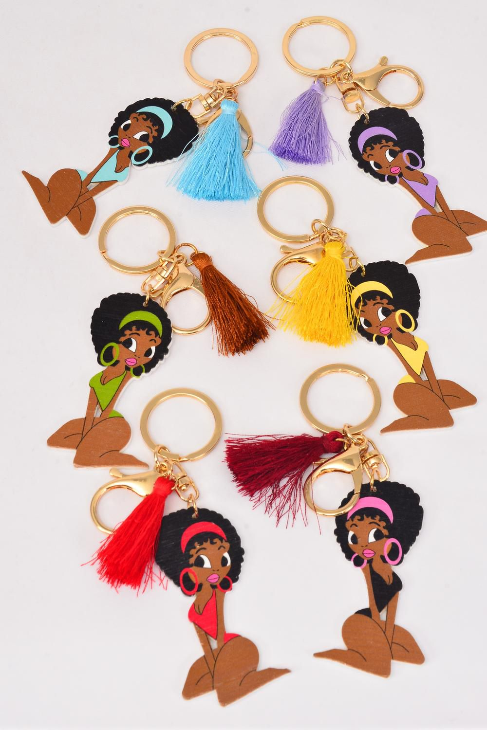 "Key Chain Ethnic Wood Color Asst/DZ Size-2.75""x 1.25"" Wide,2 of each Color Asst,Hang Tag & OPP Bag & UPC Code"