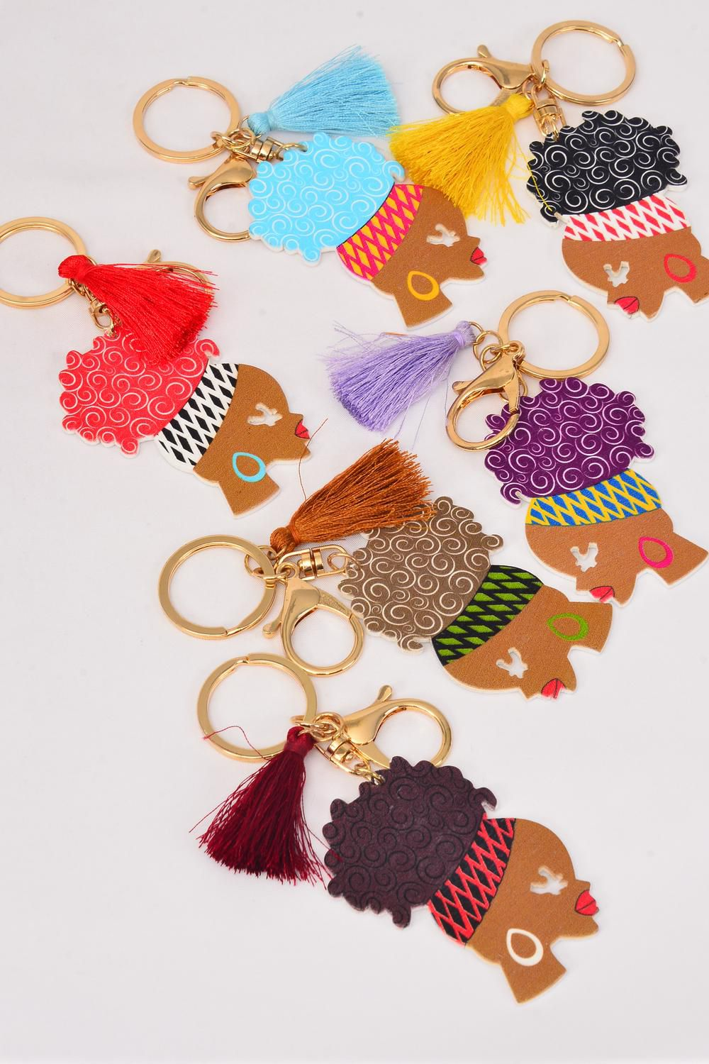 "Key Chain Ethnic Wood Tassel Color Asst/DZ Face Size-2.75""x 1.75"" Wide,2 of each Color Asst,Hang Tag & OPP Bag & UPC Code"